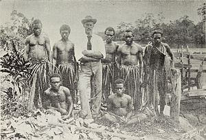 English: Fijian native trading with white traders.