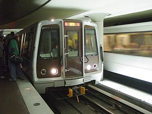 A Red Line train services Metro Center, one of...