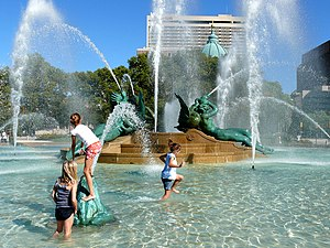 Children playing in Swann Memorial Fountain, w...