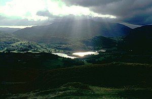 English: Gathering storm over Wetherlam with r...