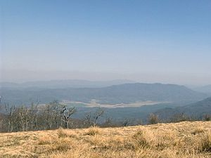 Cades Cove, the white strip at the center, loo...