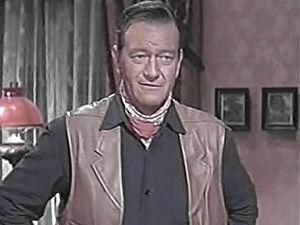 English: John Wayne in McLintock! (cropped scr...