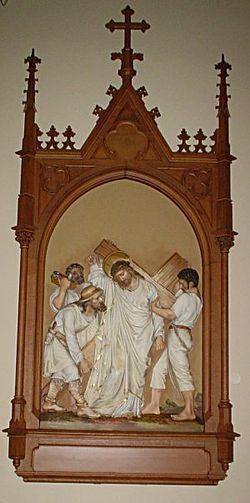 Simon of Cyrene helps Jesus carry the cross