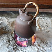 Taiwanese tea kettle over hot coals