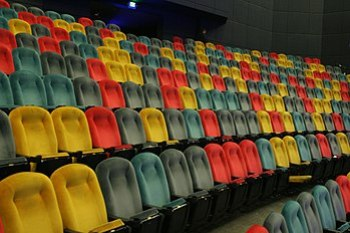 Empty IMAX theater with multicolored seats