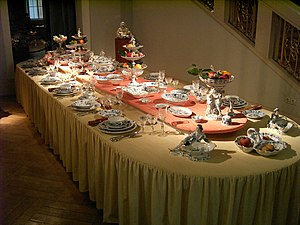 A formally laid table set with a Meissen dinne...