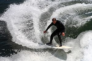 A surfer performing a gash, or very sharp turn...
