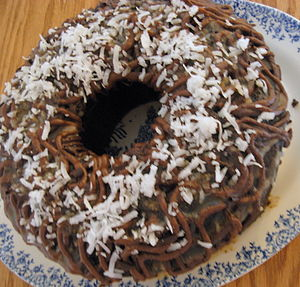 Chocolate Bundt cake frosted with coconut
