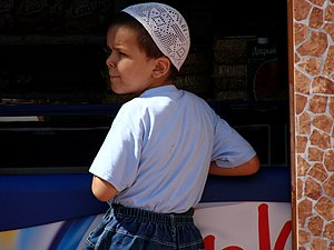 Young Muslim boy at souvenir stand outside the...
