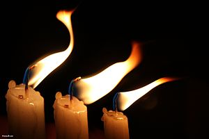 Candles Flame in the Wind by Photos8.com