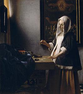 Woman Holding a Balance (Vermeer).jpg