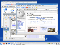 KDE 3.5, showing the Kontact personal information manager and Konqueror file manager, web browser, and file viewer.