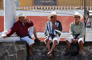 English: Tz'utujil men hanging around Santiago...