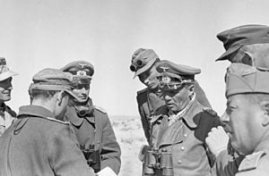 Rommel conversing with his staff near El Aghei...