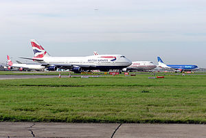 Queue of aircraft for take-off including jets ...