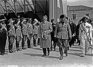 Adolf Hitler and Benito Mussolini walking in f...