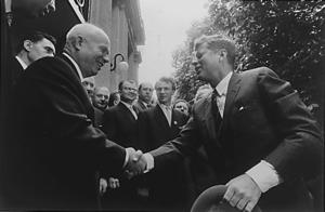 US President John F. Kennedy shaking hands wit...