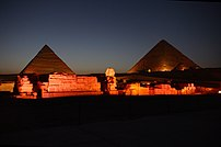 The Giza pyramid complex at night.