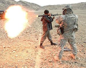 U.S. Army Staff Sgt. Johnson coaches an Afghan...