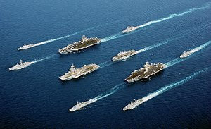 Naval vessels from five nations sail in parade...