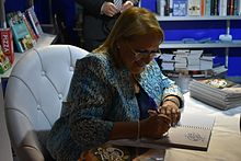 Coleiro Preca, as President, signing books at the MCC in Valletta