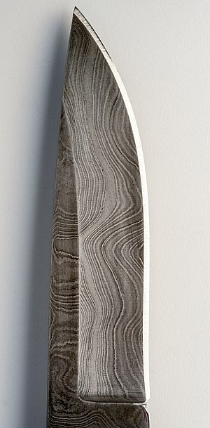 Close-up of a modern pattern welded damascus s...