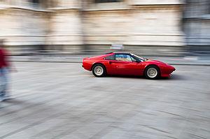 Ferrari speeding at Piazza Duomo, Milan.