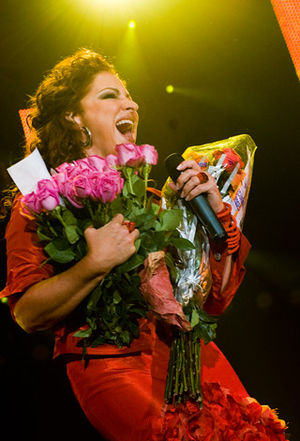 Gloria Estefan receiving flowers for her birth...