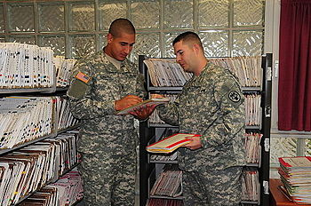 Spc. Jose Gonzalez, left, and Sgt. Jeffrey Cook inventory and organize the thousands of medical records in the Mannheim Army health clinic in preparation for its closure Sept. 30. The health center located on Benjamin Franklin Village originally opened in 1956. All active duty records will transfer to Coleman Barracks Troop Medical Clinic.