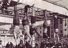 Bodies of Benito Mussolini, his mistress Clara Petacci, and three others hanging outside a petrol station in Milan