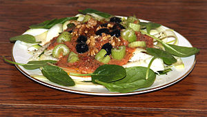 A raw vegan tomato sauce with olives, celery, ...