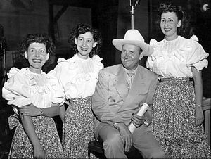 Publicity photo of Gene Autry and the vocal gr...