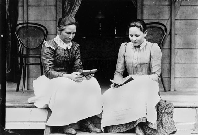 File Statelibqld 1 132733 Two Women Reading On A Verandah