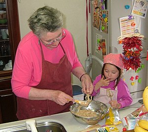 Taste-testing the cookie dough with Grandm