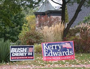 Neighborhing yard signs for George W. Bush and...