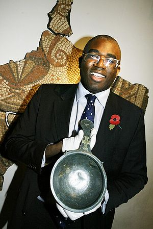 MP David Lammy posing with an early medieval s...