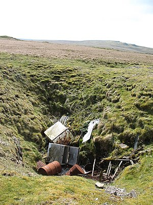 sink hole plot tip rubbish ditch