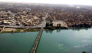 The Tigris River as it flows through Mosul, Ir...