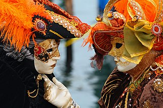 Masked lovers at Venice Carnival