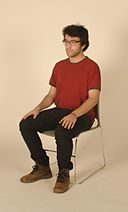 Young man sitting in a chair, Feb 2014