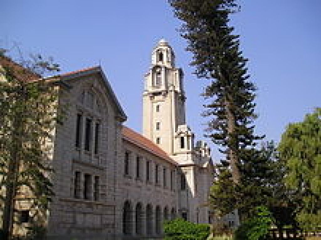 3-storey stone building with taller ivory tower