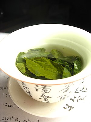 Green tea leaves steeping in an uncovered zhon...