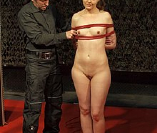 A Male Bondage Rigger Demonstrates To The Audience On How To Do Rope Bondage At Boundcon 2015 Event In Germany The Bondage Technique Used Here Is Box Tie