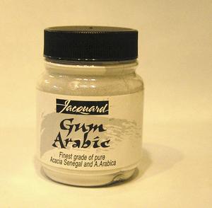 English: Gum arabic powder in tub