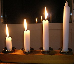 English: Three candles lit for the three first...