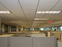An image of a lot of cubicles that seem to go ...