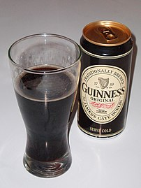 Can of Guinness Original, plus the beer in a glass
