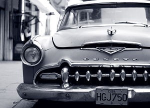 The streets in Havana are lined with cars, a b...