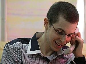 English: SFC Gilad Shalit on the phone with hi...