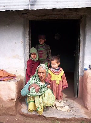 Old woman and children in a doorway in the Ind...